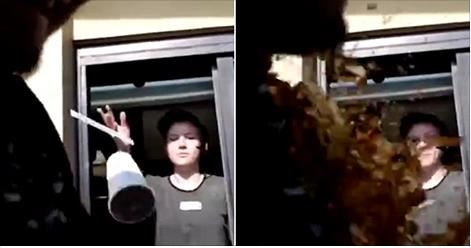 Would you like a napkin with that? Perfect moment McDonald's drive-thru girl throws large Coke over driver after he deliberately beeps his horn to scare her