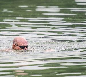 Naked swimmer hospitalized