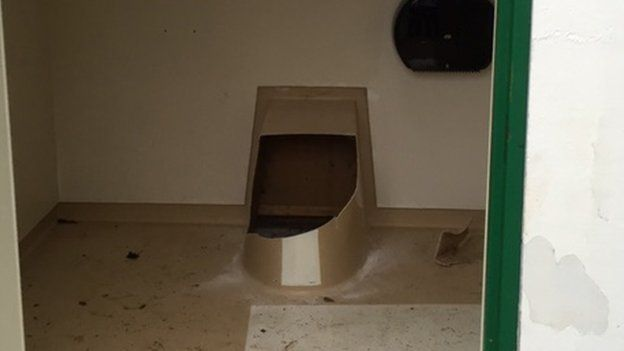 Norway man rescued after climbing into public toilet